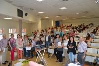 Participantes, profesores, preparadores y comisión de la Olimpiada en el aula de la prueba