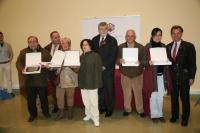 Los homenajeados, junto al rector y directivos universitarios
