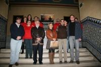 Voluntarios y participantes en el acto de presentación