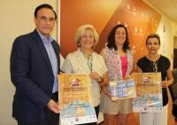 De izquierda a derecha, José Carlos Gómez Villamandos, Esperanza Jaqueti, Esperanza Pericet y Rosario Mérida, con el cartel anunciador del Congreso