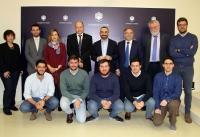 Foto de familia de jurado y participantes.